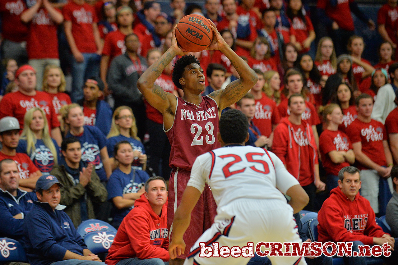 Nov. 18, 2014: New Mexico State Aggies guard Daniel Mullings (23) surveys the defense during a game between New Mexico State vs. St. Mary's College in Moraga, Calif. in the ESPN College Hoops Tipoff Marathon. Saint Mary's defeated New Mexico State 83-71.