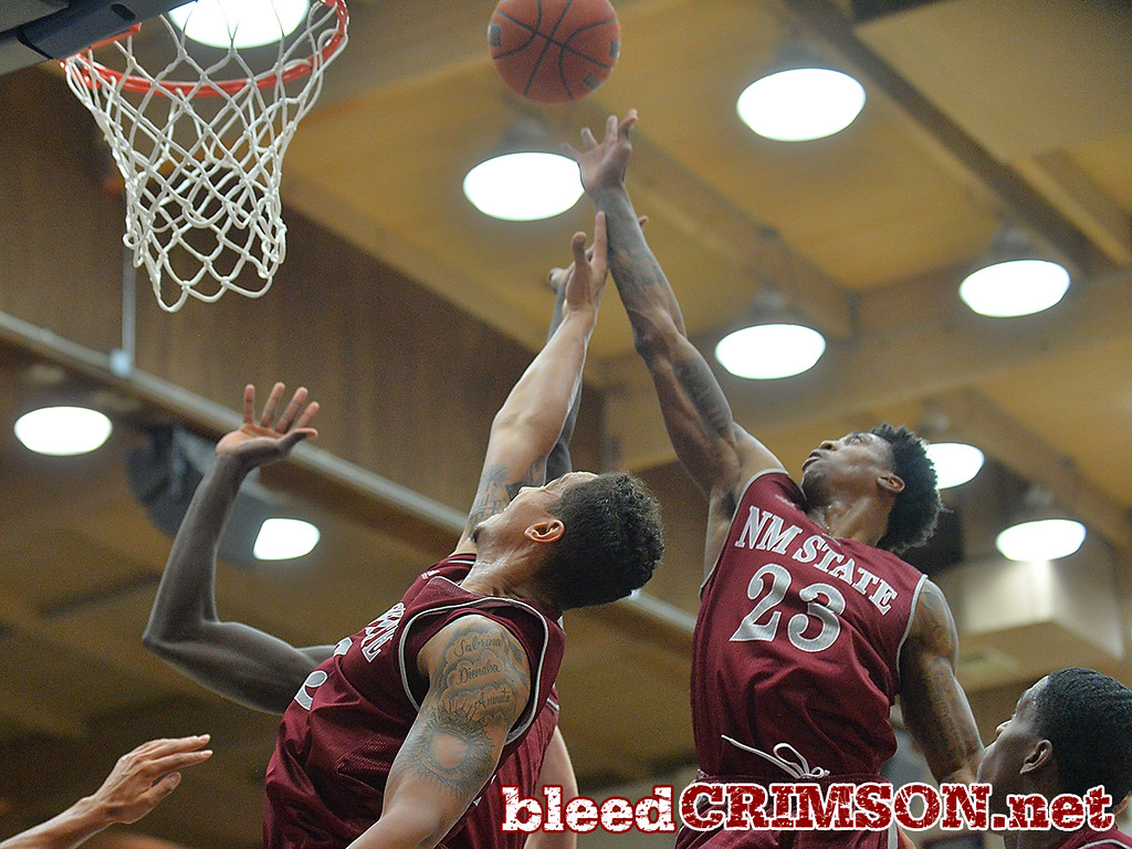 Nov. 18, 2014: New Mexico State Aggies guard Daniel Mullings (23) and New Mexico State Aggies forward Remi Barry (3) battle for a rebound during a game between New Mexico State vs. St. Mary's College in Moraga, Calif. in the ESPN College Hoops Tipoff Marathon. Saint Mary's defeated New Mexico State 83-71.