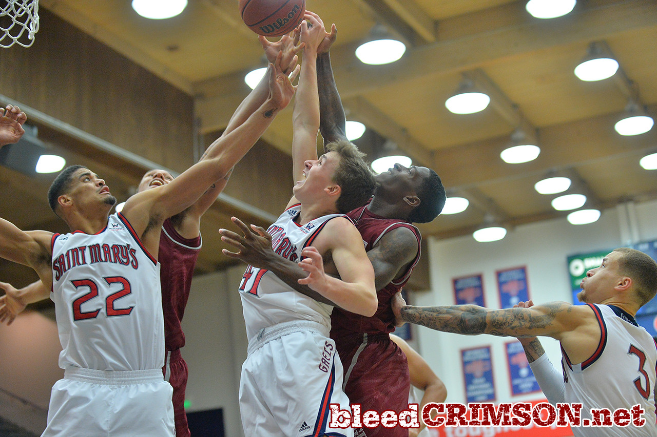 Nov. 18, 2014: St. Mary's Gaels forward Garrett Jackson (22) and St. Mary's Gaels guard Emmett Naar (41) battle New Mexico State Aggies forward Remi Barry (3) for a rebound during a game between New Mexico State vs. St. Mary's College in Moraga, Calif. in the ESPN College Hoops Tipoff Marathon. Saint Mary's defeated New Mexico State 83-71.
