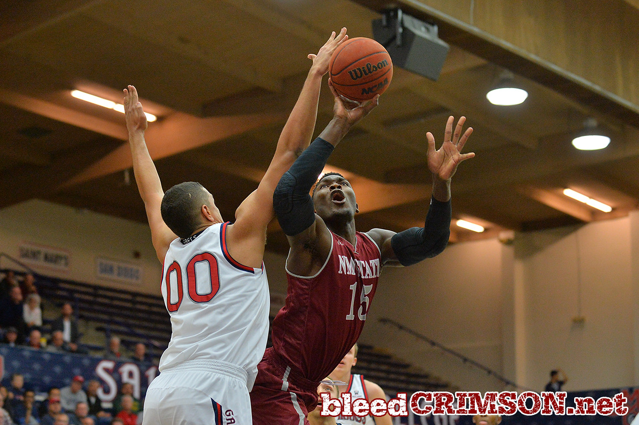 Nov. 18, 2014: New Mexico State Aggies center Tshilidzi Nephawe (15) puts up a shot over St. Mary's Gaels forward Brad Waldow (00) during a game between New Mexico State vs. St. Mary's College in Moraga, Calif. in the ESPN College Hoops Tipoff Marathon. Saint Mary's defeated New Mexico State 83-71.