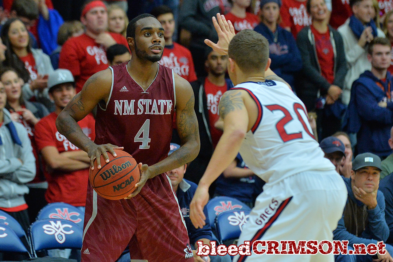 Nov. 18, 2014: New Mexico State Aggies guard Ian Baker (4) surveys the defense during a game between New Mexico State vs. St. Mary's College in Moraga, Calif. in the ESPN College Hoops Tipoff Marathon. Saint Mary's defeated New Mexico State 83-71.