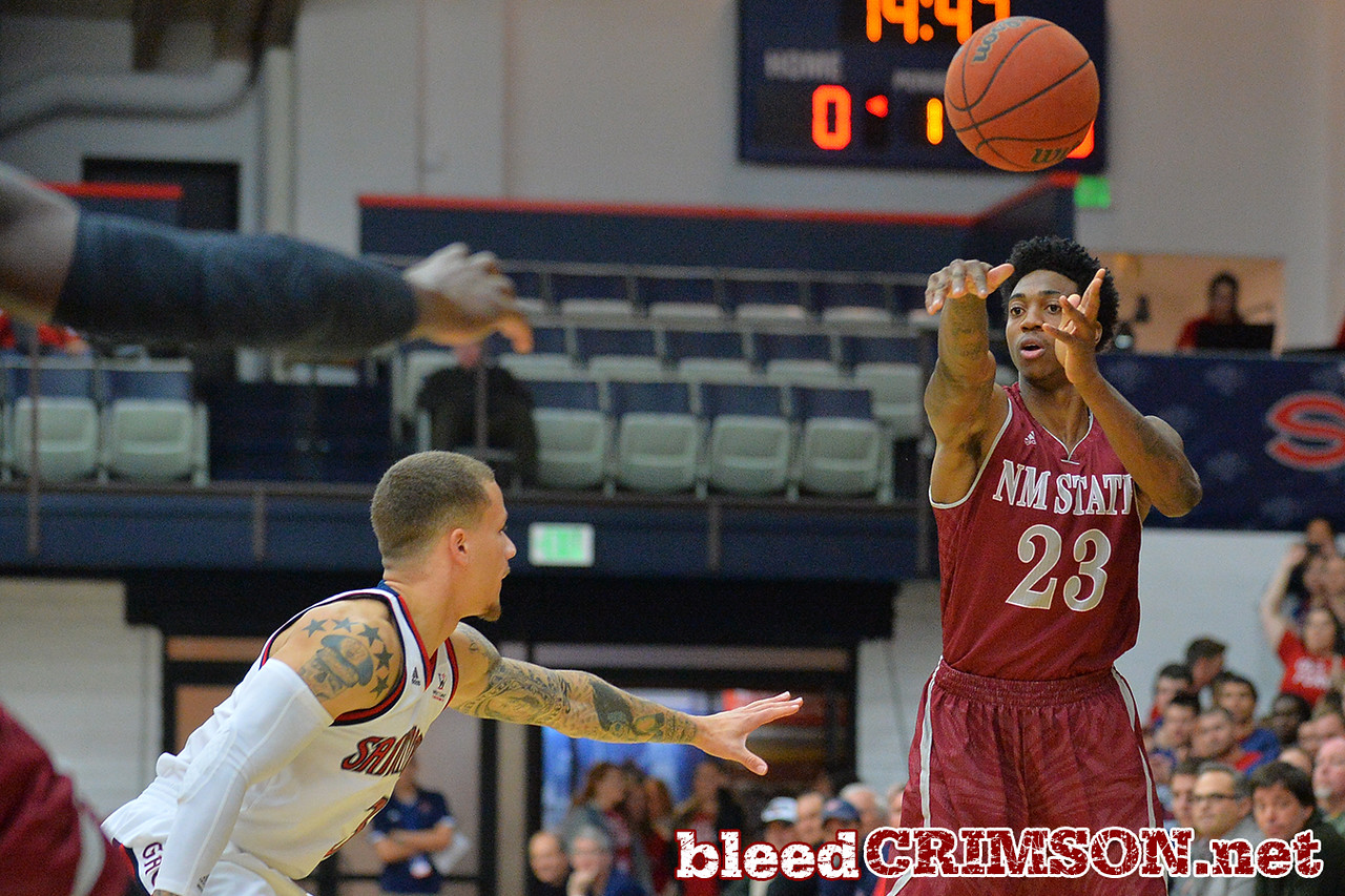 Nov. 18, 2014: New Mexico State Aggies guard Daniel Mullings (23) passes the ball to a teammate during a game between New Mexico State vs. St. Mary's College in Moraga, Calif. in the ESPN College Hoops Tipoff Marathon. Saint Mary's defeated New Mexico State 83-71.