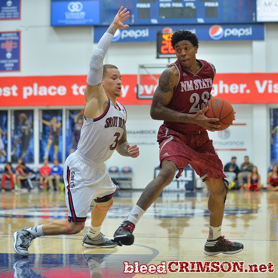 Nov. 18, 2014: New Mexico State Aggies guard Daniel Mullings (23) tries to get past St. Mary's Gaels guard Kerry Carter (3) during a game between New Mexico State vs. St. Mary's College in Moraga, Calif. in the ESPN College Hoops Tipoff Marathon. Saint Mary's defeated New Mexico State 83-71.