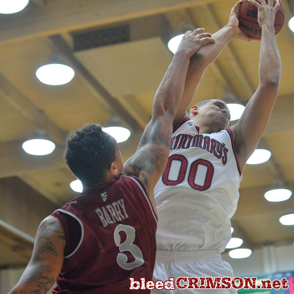 Nov. 18, 2014: New Mexico State Aggies forward Remi Barry (3) battles St. Mary's Gaels forward Brad Waldow (00) for a rebound during a game between New Mexico State vs. St. Mary's College in Moraga, Calif. in the ESPN College Hoops Tipoff Marathon. Saint Mary's defeated New Mexico State 83-71.
