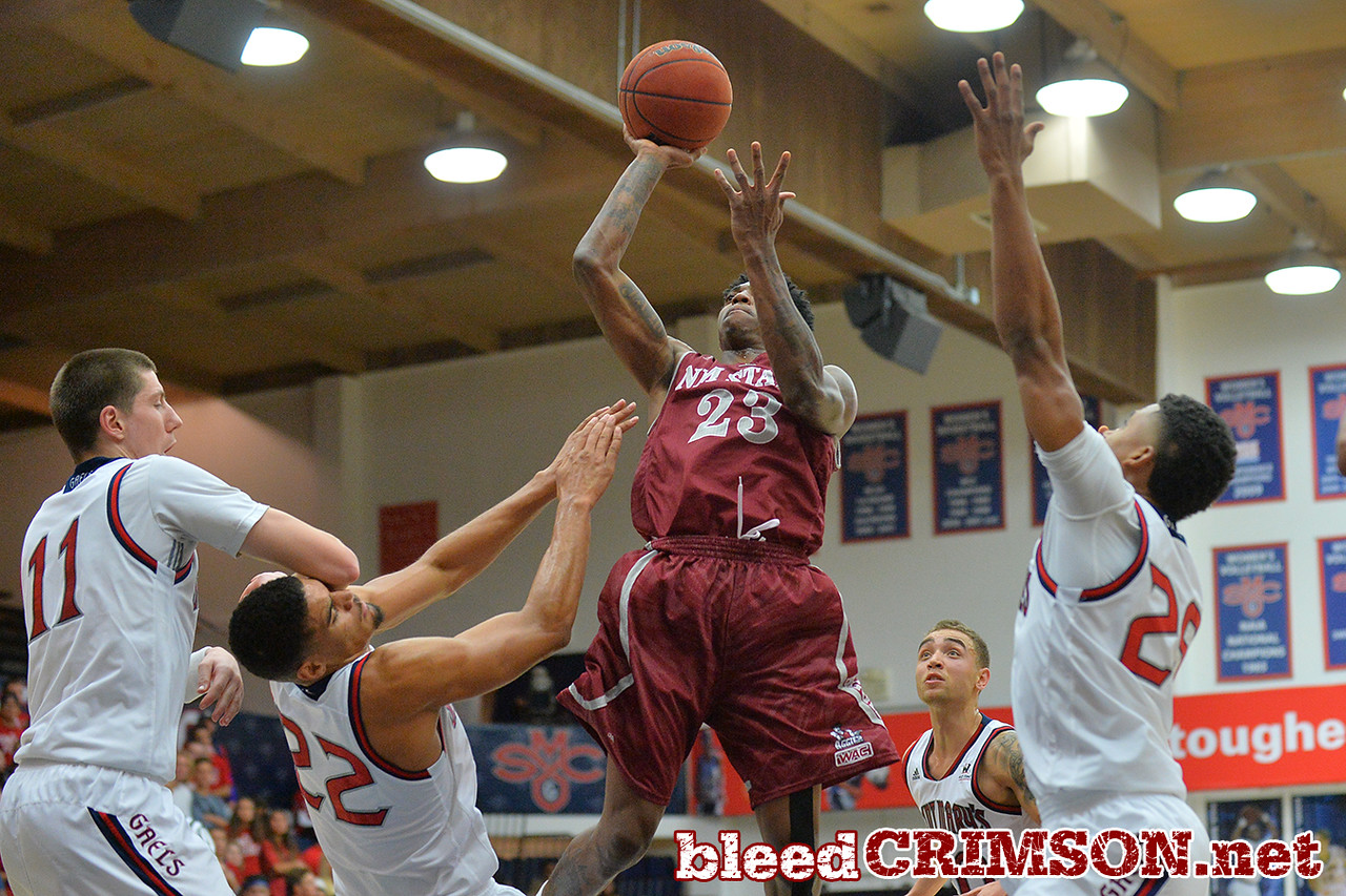 Nov. 18, 2014: New Mexico State Aggies guard Daniel Mullings (23) drives to the basket during a game between New Mexico State vs. St. Mary's College in Moraga, Calif. in the ESPN College Hoops Tipoff Marathon. Saint Mary's defeated New Mexico State 83-71.
