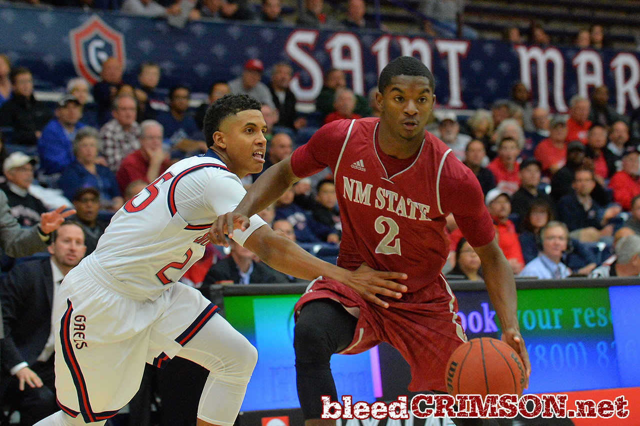 Nov. 18, 2014: New Mexico State Aggies guard Braxton Huggins (2) drives past St. Mary's Gaels guard Treaven Duffy (25) during a game between New Mexico State vs. St. Mary's College in Moraga, Calif. in the ESPN College Hoops Tipoff Marathon. Saint Mary's defeated New Mexico State 83-71.