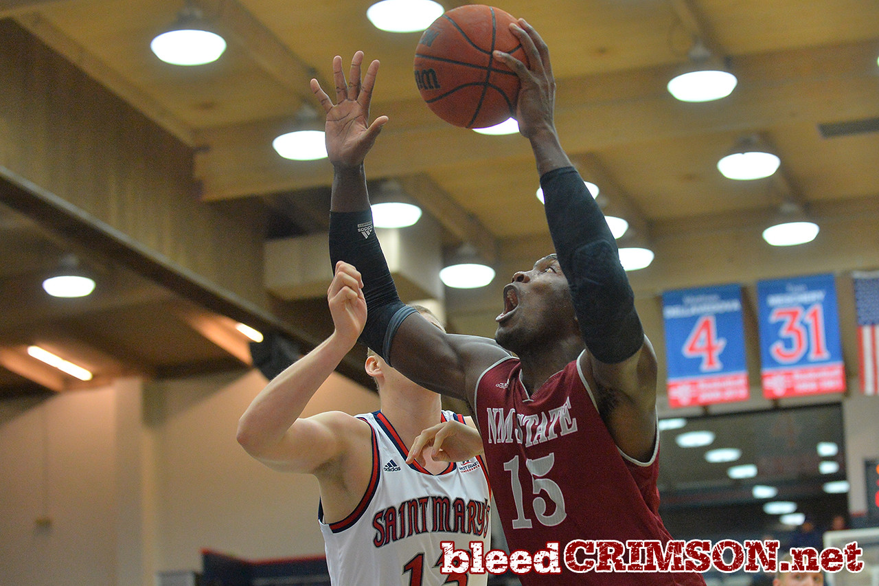 Nov. 18, 2014: New Mexico State Aggies center Tshilidzi Nephawe (15) drives to the basket during a game between New Mexico State vs. St. Mary's College in Moraga, Calif. in the ESPN College Hoops Tipoff Marathon. Saint Mary's defeated New Mexico State 83-71.