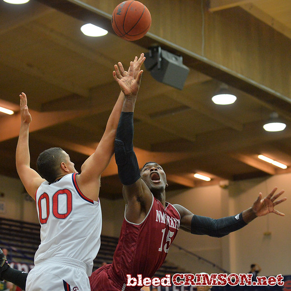 Nov. 18, 2014: New Mexico State Aggies center Tshilidzi Nephawe (15) puts up a shot and is fouled by St. Mary's Gaels forward Brad Waldow (00) during a game between New Mexico State vs. St. Mary's College in Moraga, Calif. in the ESPN College Hoops Tipoff Marathon. Saint Mary's defeated New Mexico State 83-71.
