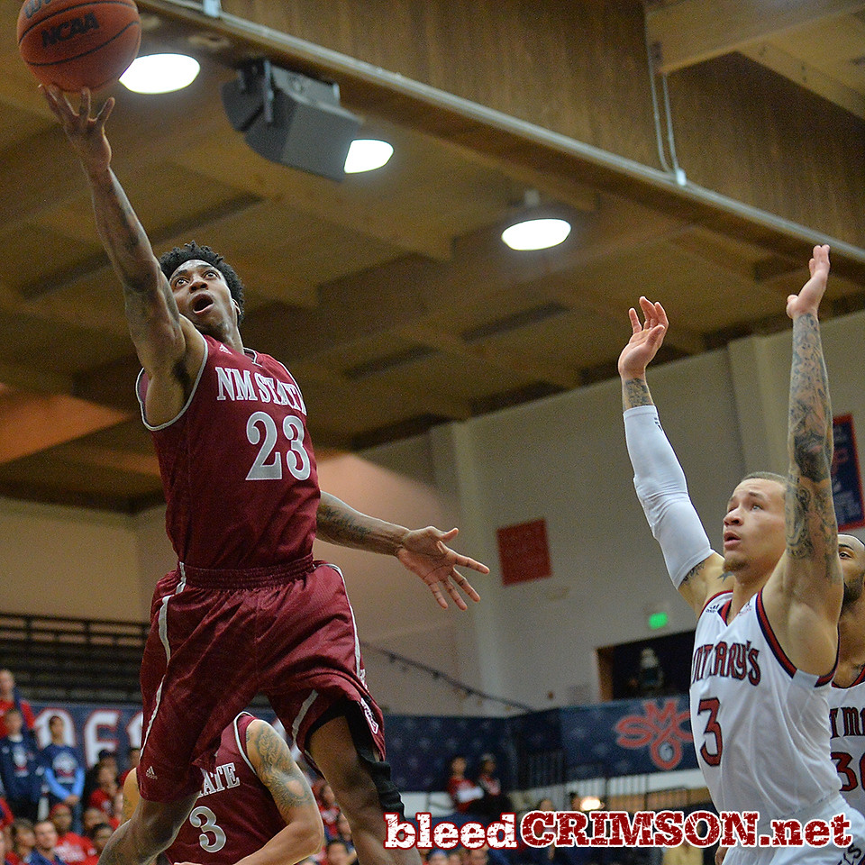 Nov. 18, 2014: New Mexico State Aggies guard Daniel Mullings (23) puts up a shot over St. Mary's Gaels guard Kerry Carter (3) during a game between New Mexico State vs. St. Mary's College in Moraga, Calif. in the ESPN College Hoops Tipoff Marathon. Saint Mary's defeated New Mexico State 83-71.