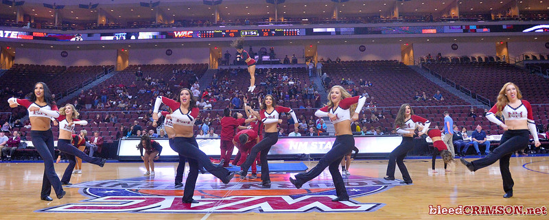 LAS VEGAS, NV - MARCH 08:  The New Mexico State Aggies Sundancers and cheerleaders perform during halftime of the team's quarterfinal game of the Western Athletic Conference basketball tournament against the Chicago State Cougars at the Orleans Arena in Las Vegas, Nevada. The Aggies won 97-70.