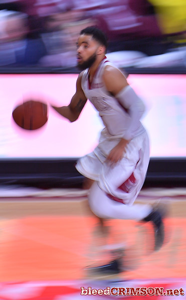 LAS VEGAS, NV - MARCH 08:  Shunn Buchanan #1 of the New Mexico State Aggies brings the ball up the court against the Chicago State Cougars during a quarterfinal game of the Western Athletic Conference basketball tournament at the Orleans Arena in Las Vegas, Nevada. The Aggies won 97-70.