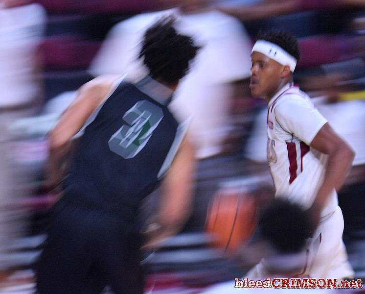 LAS VEGAS, NV - MARCH 08:  Shunn Buchanan #1 of the New Mexico State Aggies dribbles against Deionte Simmons #3 of the Chicago State Cougars during a quarterfinal game of the Western Athletic Conference basketball tournament at the Orleans Arena in Las Vegas, Nevada. The Aggies won 97-70.