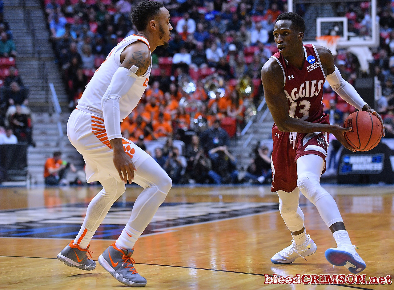 SAN DIEGO, CA - MARCH 16:  Sidy N'Dir #13 of the New Mexico State Aggies looks to pass against Marcquise Reed #2 of the Clemson Tigers during a first round game of the Men's NCAA Basketball Tournament at Viejas Arena in San Diego, California. Clemson won 79-68.  (Photo by Sam Wasson)