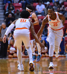 SAN DIEGO, CA - MARCH 16:  Aamir Simms #25 and Gabe DeVoe #10 of the Clemson Tigers celebrate on the court after making a three-pointer against the New Mexico State Aggies during a first round game of the Men's NCAA Basketball Tournament at Viejas Arena in San Diego, California. Clemson won 79-68.  (Photo by Sam Wasson)