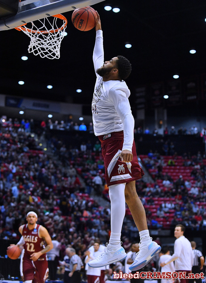 SAN DIEGO, CA - MARCH 16:  Shunn Buchanan #1 of the New Mexico State Aggies warms up before a first round game of the Men's NCAA Basketball Tournament against the Clemson Tigers at Viejas Arena in San Diego, California. Clemson won 79-68.  (Photo by Sam Wasson)