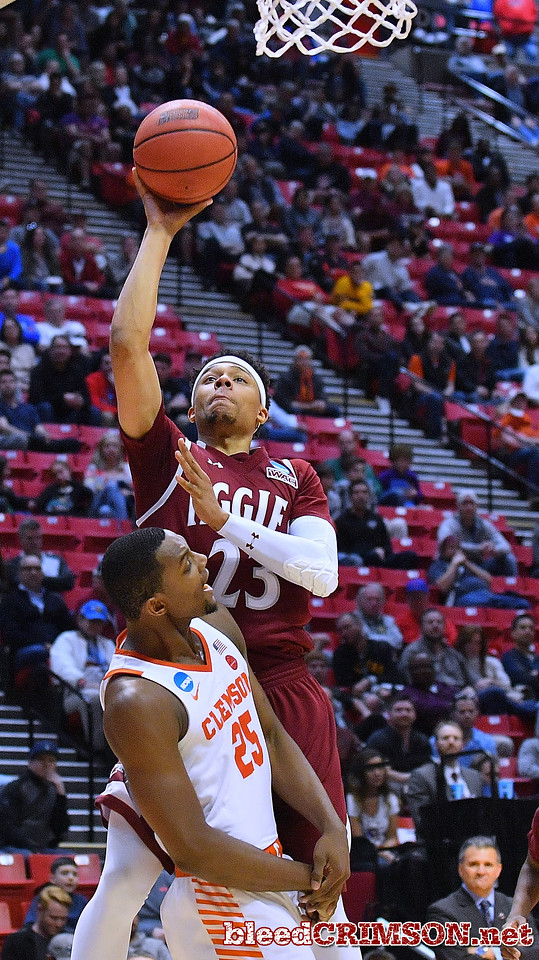 SAN DIEGO, CA - MARCH 16:  Zach Lofton #23 of the New Mexico State Aggies shoots against Aamir Simms #25 of the Clemson Tigers during a first round game of the Men's NCAA Basketball Tournament at Viejas Arena in San Diego, California. Clemson won 79-68.  (Photo by Sam Wasson)