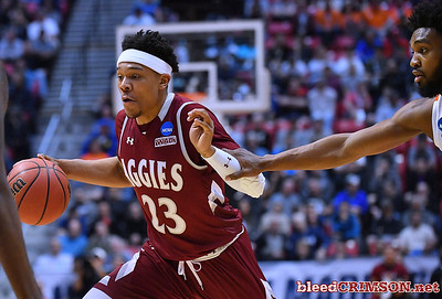 SAN DIEGO, CA - MARCH 16:  Zach Lofton #23 of the New Mexico State Aggies is fouled driving to the basket against the Clemson Tigers during a first round game of the Men's NCAA Basketball Tournament at Viejas Arena in San Diego, California.  (Photo by Sam Wasson)