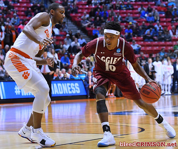 SAN DIEGO, CA - MARCH 16:  Jemerrio Jones #10 of the New Mexico State Aggies drives against Aamir Simms #25 of the Clemson Tigers during a first round game of the Men's NCAA Basketball Tournament at Viejas Arena in San Diego, California. Clemson won 79-68.  (Photo by Sam Wasson)
