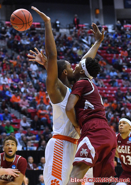 SAN DIEGO, CA - MARCH 16:  Jemerrio Jones #10 of the New Mexico State Aggies shoots against Aamir Simms #25 of the Clemson Tigers during a first round game of the Men's NCAA Basketball Tournament at Viejas Arena in San Diego, California. Clemson won 79-68.  (Photo by Sam Wasson)