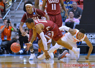 SAN DIEGO, CA - MARCH 16:  A.J. Harris #12 of the New Mexico State Aggies steals the ball from Marcquise Reed #2 of the Clemson Tigers during a first round game of the Men's NCAA Basketball Tournament at Viejas Arena in San Diego, California. Clemson won 79-68.  (Photo by Sam Wasson)