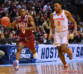 SAN DIEGO, CA - MARCH 16:  Keyon Jones #0 of the New Mexico State Aggies brings the ball up the court against Clyde Trapp #0 of the Clemson Tigers during a first round game of the Men's NCAA Basketball Tournament at Viejas Arena in San Diego, California.  (Photo by Sam Wasson)