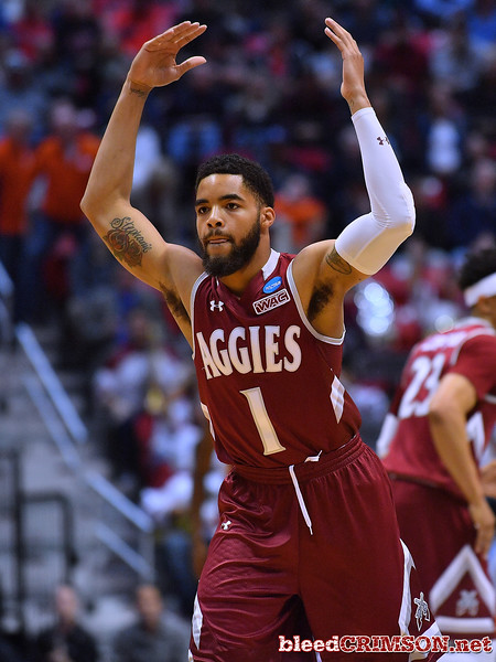 SAN DIEGO, CA - MARCH 16:  Shunn Buchanan #1 of the New Mexico State Aggies celebrates after making a three-pointer against the Clemson Tigers during a first round game of the Men's NCAA Basketball Tournament at Viejas Arena in San Diego, California.  (Photo by Sam Wasson)