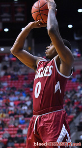 SAN DIEGO, CA - MARCH 16:  Keyon Jones #0 of the New Mexico State Aggies shoots a three-pointer against the Clemson Tigers during a first round game of the Men's NCAA Basketball Tournament at Viejas Arena in San Diego, California. Clemson won 79-68.  (Photo by Sam Wasson)
