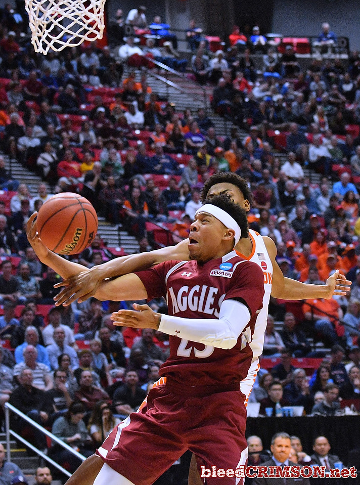 SAN DIEGO, CA - MARCH 16:  Zach Lofton #23 of the New Mexico State Aggies is fouled by Clyde Trapp #0 of the Clemson Tigers during a first round game of the Men's NCAA Basketball Tournament at Viejas Arena in San Diego, California. Clemson won 79-68.  (Photo by Sam Wasson)