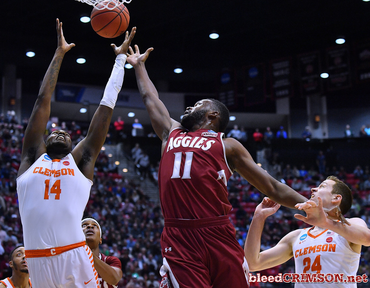 SAN DIEGO, CA - MARCH 16:  Johnathon Wilkins #11 of the New Mexico State Aggies battles Elijah Thomas #14 of the Clemson Tigers for a rebound during a first round game of the Men's NCAA Basketball Tournament at Viejas Arena in San Diego, California.  (Photo by Sam Wasson)