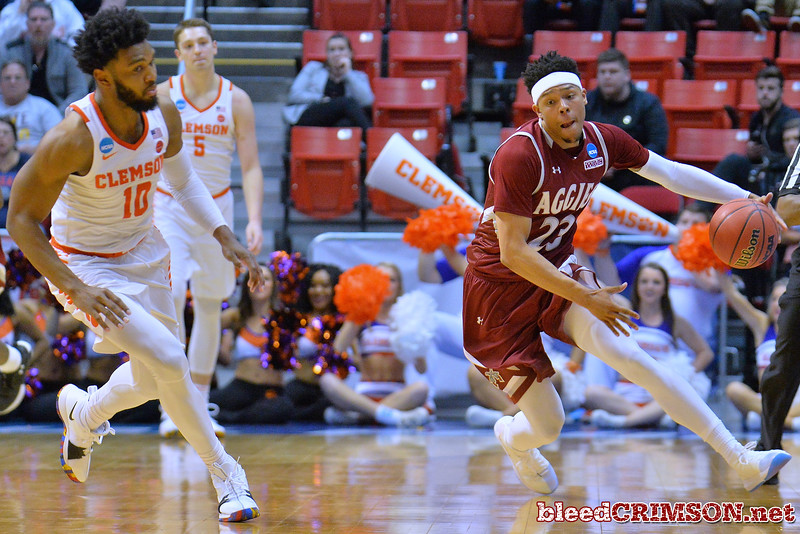 SAN DIEGO, CA - MARCH 16:  Zach Lofton #23 of the New Mexico State Aggies dribbles against Gabe DeVoe #10 of the Clemson Tigers during a first round game of the Men's NCAA Basketball Tournament at Viejas Arena in San Diego, California. Clemson won 79-68.  (Photo by Sam Wasson)