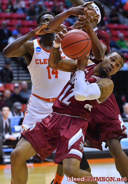 SAN DIEGO, CA - MARCH 16:  A.J. Harris #12 of the New Mexico State Aggies fights for a rebound against Elijah Thomas #14 of the Clemson Tigers during a first round game of the Men's NCAA Basketball Tournament at Viejas Arena in San Diego, California. Clemson won 79-68.  (Photo by Sam Wasson)