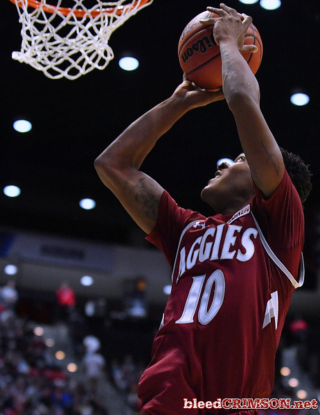 SAN DIEGO, CA - MARCH 16:  Jemerrio Jones #10 of the New Mexico State Aggies gets a layup against the Clemson Tigers during a first round game of the Men's NCAA Basketball Tournament at Viejas Arena in San Diego, California.  (Photo by Sam Wasson)