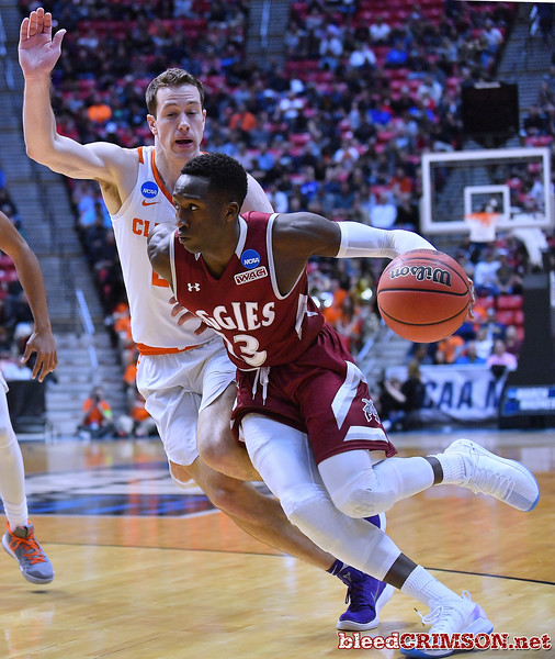 SAN DIEGO, CA - MARCH 16:  Sidy N'Dir #13 of the New Mexico State Aggies drives against David Skara #24 of the Clemson Tigers during a first round game of the Men's NCAA Basketball Tournament at Viejas Arena in San Diego, California. Clemson won 79-68.  (Photo by Sam Wasson)