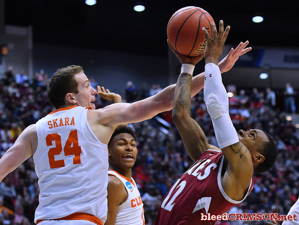SAN DIEGO, CA - MARCH 16:  A.J. Harris #12 of the New Mexico State Aggies is fouled by David Skara #24 of the Clemson Tigers during a first round game of the Men's NCAA Basketball Tournament at Viejas Arena in San Diego, California.  (Photo by Sam Wasson)