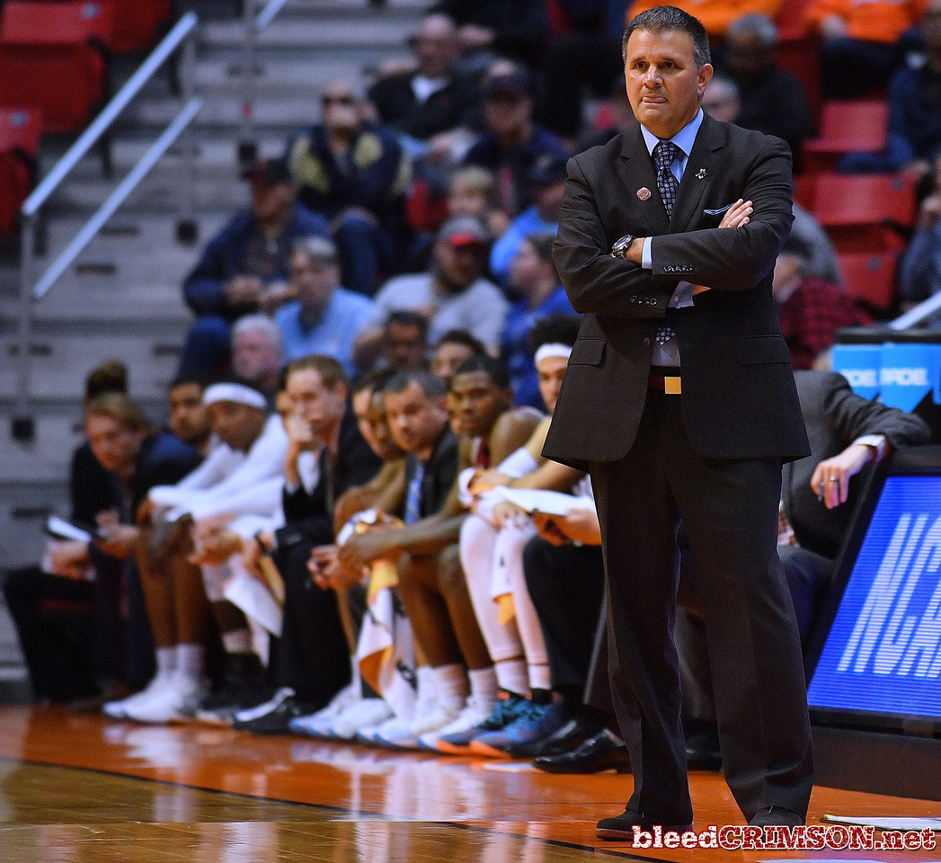 SAN DIEGO, CA - MARCH 16:  Head coach Chris Jans of the New Mexico State Aggies looks on during a first round game of the Men's NCAA Basketball Tournament against the Clemson Tigers at Viejas Arena in San Diego, California.  (Photo by Sam Wasson)