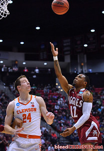 SAN DIEGO, CA - MARCH 16:  A.J. Harris #12 of the New Mexico State Aggies shoots against Elijah Thomas #14 of the Clemson Tigers during a first round game of the Men's NCAA Basketball Tournament at Viejas Arena in San Diego, California. Clemson won 79-68.  (Photo by Sam Wasson)