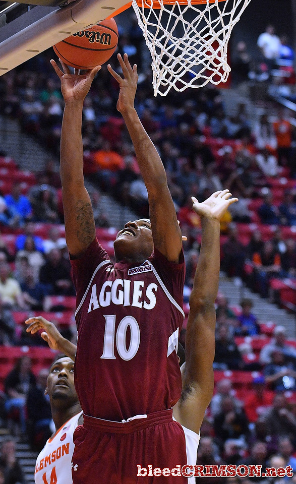 SAN DIEGO, CA - MARCH 16:  Jemerrio Jones #10 of the New Mexico State Aggies gets a layup against Elijah Thomas #14 of the Clemson Tigers during a first round game of the Men's NCAA Basketball Tournament at Viejas Arena in San Diego, California. Clemson won 79-68.  (Photo by Sam Wasson)