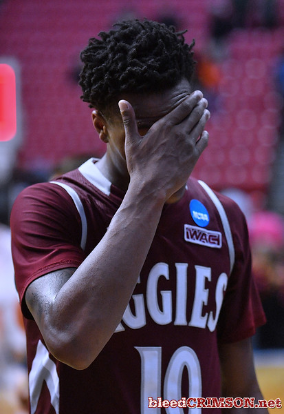SAN DIEGO, CA - MARCH 16:  Jemerrio Jones #10 of the New Mexico State Aggies reacts after losing 79-68 to the Clemson Tigers during a first round game of the Men's NCAA Basketball Tournament at Viejas Arena in San Diego, California.  (Photo by Sam Wasson)