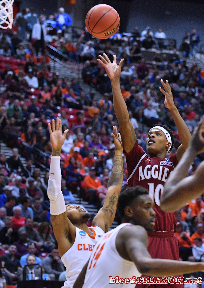 SAN DIEGO, CA - MARCH 16:  Jemerrio Jones #10 of the New Mexico State Aggies shoots against Shelton Mitchell #4 of the Clemson Tigers during a first round game of the Men's NCAA Basketball Tournament at Viejas Arena in San Diego, California. Clemson won 79-68.  (Photo by Sam Wasson)