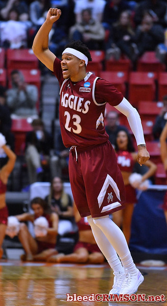 SAN DIEGO, CA - MARCH 16:  Zach Lofton #23 of the New Mexico State Aggies reacts after hitting a shot against the Clemson Tigers during a first round game of the Men's NCAA Basketball Tournament at Viejas Arena in San Diego, California. Clemson won 79-68.  (Photo by Sam Wasson)
