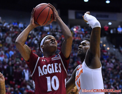 SAN DIEGO, CA - MARCH 16:  Jemerrio Jones #10 of the New Mexico State Aggies shoots against Elijah Thomas #14 of the Clemson Tigers during a first round game of the Men's NCAA Basketball Tournament at Viejas Arena in San Diego, California.  (Photo by Sam Wasson)