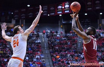 SAN DIEGO, CA - MARCH 16:  Johnathon Wilkins #11 of the New Mexico State Aggies shoots against David Skara #24 of the Clemson Tigers during a first round game of the Men's NCAA Basketball Tournament at Viejas Arena in San Diego, California. Clemson won 79-68.  (Photo by Sam Wasson)