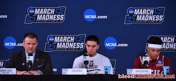 SAN DIEGO, CA - MARCH 16:  (L-R) Head coach Chris Jans, Joe Garza #15 and Zach Lofton #23 of the New Mexico State Aggies address the media after losing 79-68 to the Clemson Tigers during a first round game of the Men's NCAA Basketball Tournament at Viejas Arena in San Diego, California.  (Photo by Sam Wasson)