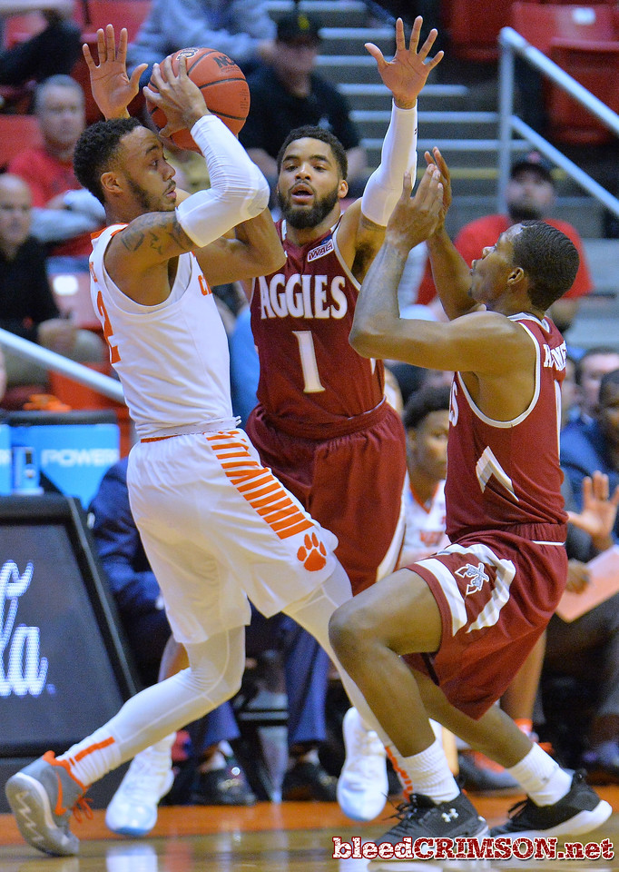 SAN DIEGO, CA - MARCH 16:  Shunn Buchanan #1 and Keyon Jones #0 of the New Mexico State Aggies trap Marcquise Reed #2 of the Clemson Tigers during a first round game of the Men's NCAA Basketball Tournament at Viejas Arena in San Diego, California. Clemson won 79-68.  (Photo by Sam Wasson)