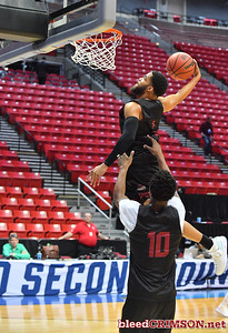 SAN DIEGO, CA - MARCH 15:  Shunn Buchanan #1 of the New Mexico State Aggies attempts a dunk during the open practice session during media day of the Men's NCAA Basketball Tournament - San Diego - Practice Sessions at Viejas Arena in San Diego, California.  (Photo by Sam Wasson/bleedCrimson.net)