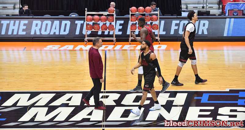 SAN DIEGO, CA - MARCH 15:  Head coach Chris Jans (L) of the New Mexico State Aggies looks on during the open practice session during media day of the Men's NCAA Basketball Tournament - San Diego - Practice Sessions at Viejas Arena in San Diego, California.  (Photo by Sam Wasson/bleedCrimson.net)