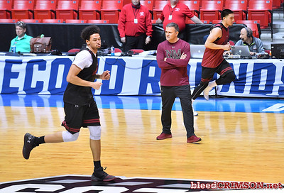 SAN DIEGO, CA - MARCH 15:  Head coach Chris Jans of the New Mexico State Aggies looks on as Eli Chuha #22 (L) and Joe Garza #15 run the length of the court during the open practice session during media day of the Men's NCAA Basketball Tournament - San Diego - Practice Sessions at Viejas Arena in San Diego, California.  (Photo by Sam Wasson/bleedCrimson.net)