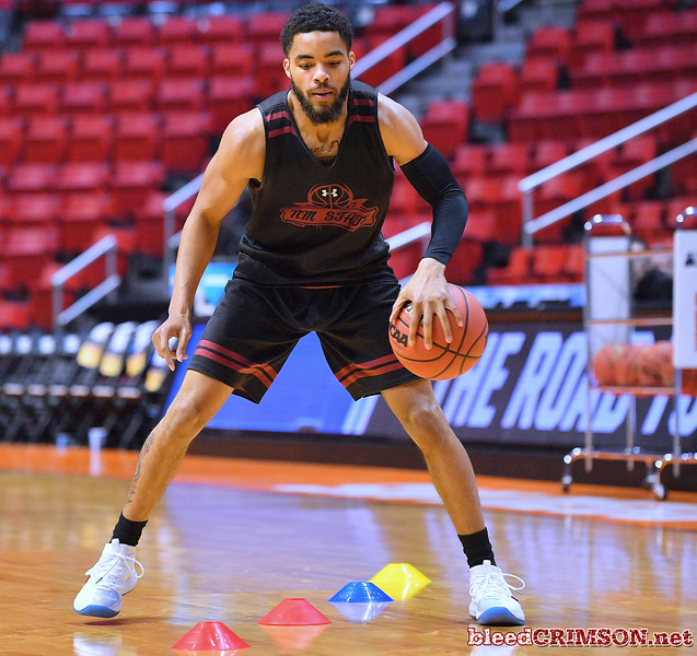 SAN DIEGO, CA - MARCH 15:  Shunn Buchanan #1 of the New Mexico State Aggies practices during the open practice session during media day of the Men's NCAA Basketball Tournament - San Diego - Practice Sessions at Viejas Arena in San Diego, California.  (Photo by Sam Wasson/bleedCrimson.net)