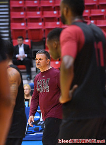 SAN DIEGO, CA - MARCH 15:  Head coach Chris Jans of the New Mexico State Aggies talks to his team during the open practice session during media day of the Men's NCAA Basketball Tournament - San Diego - Practice Sessions at Viejas Arena in San Diego, California.  (Photo by Sam Wasson/bleedCrimson.net)