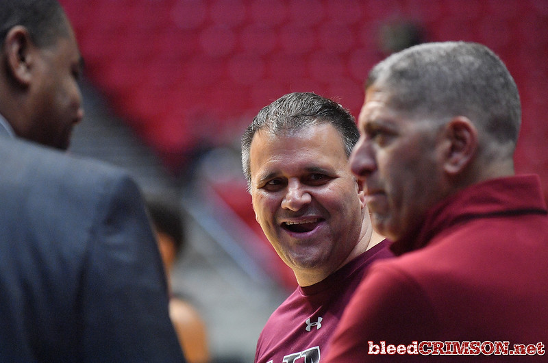 SAN DIEGO, CA - MARCH 15:  Head coach Chris Jans (C) of the New Mexico State Aggies has a conversation with athletics director Mario Moccia (R) during the open practice session during media day of the Men's NCAA Basketball Tournament - San Diego - Practice Sessions at Viejas Arena in San Diego, California.  (Photo by Sam Wasson/bleedCrimson.net)